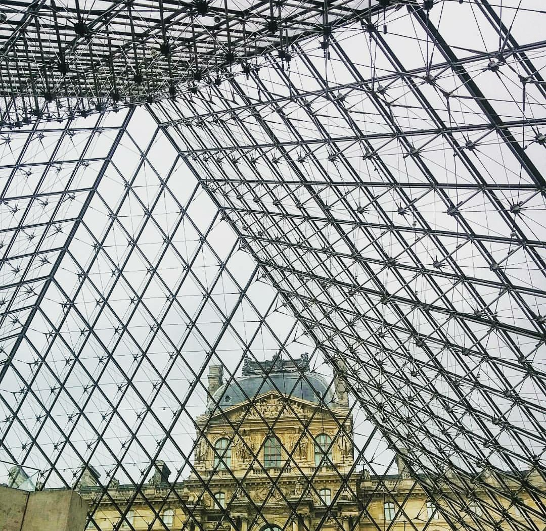 Love this view of the Pyramide du Louvre and it's amazing architecture.