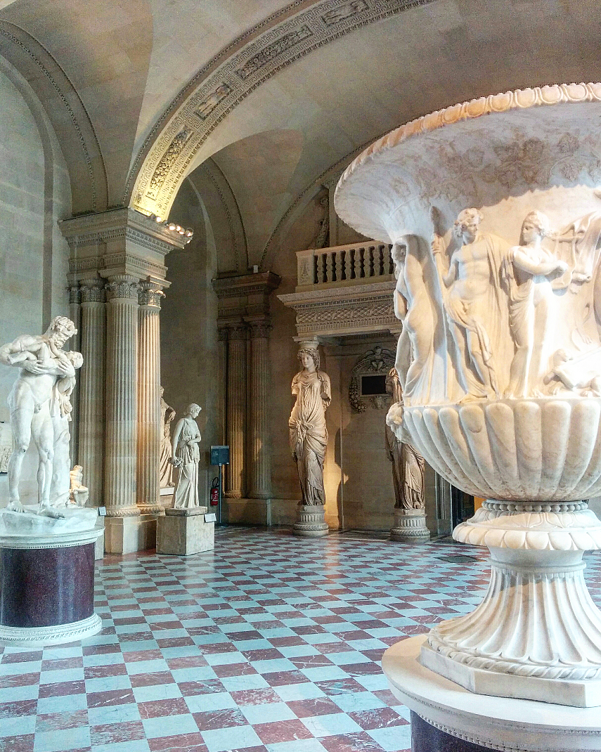 Marble from floor to ceiling with elaborately carved sculptures gracing the room.