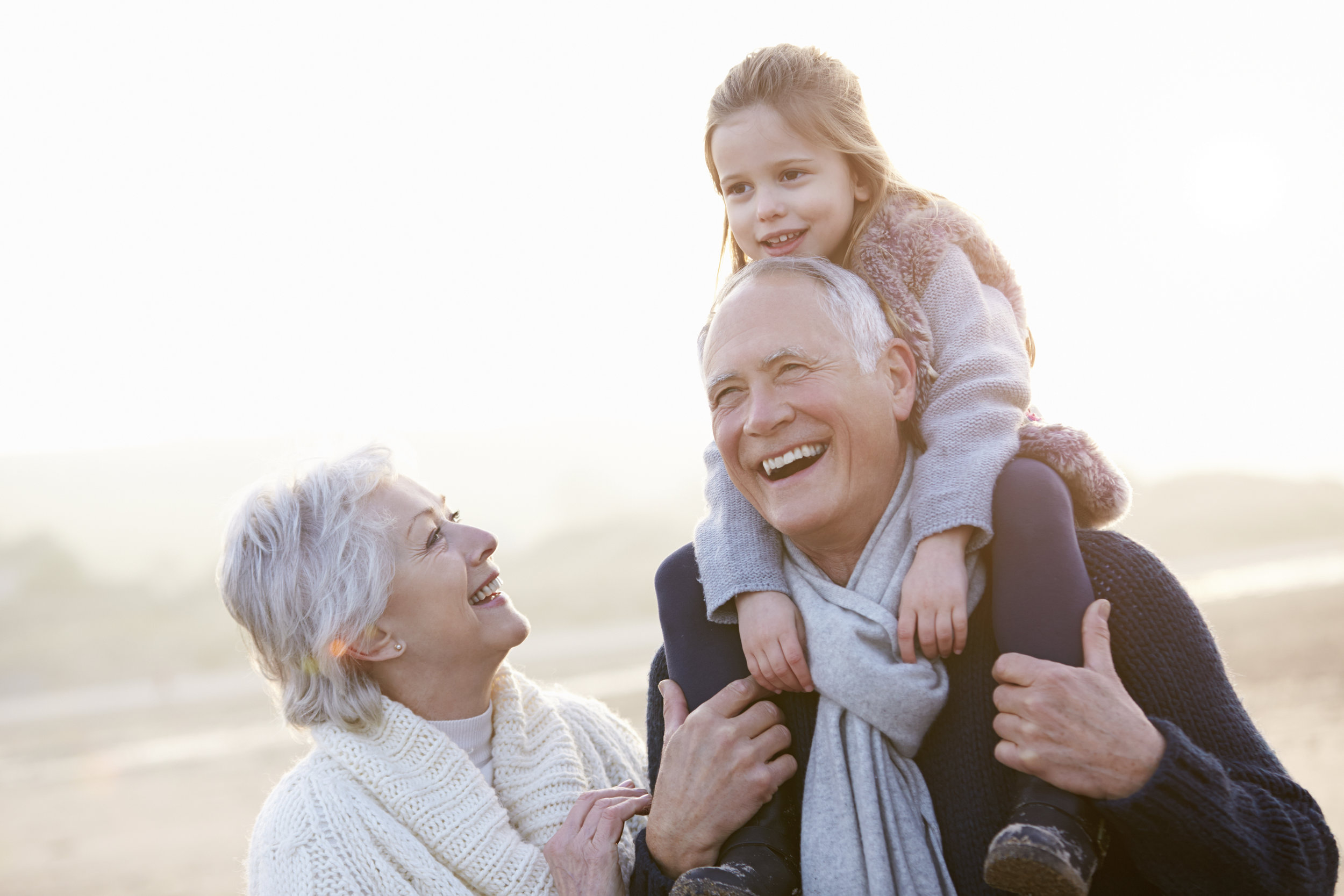 grandparents with grandaughter.jpg