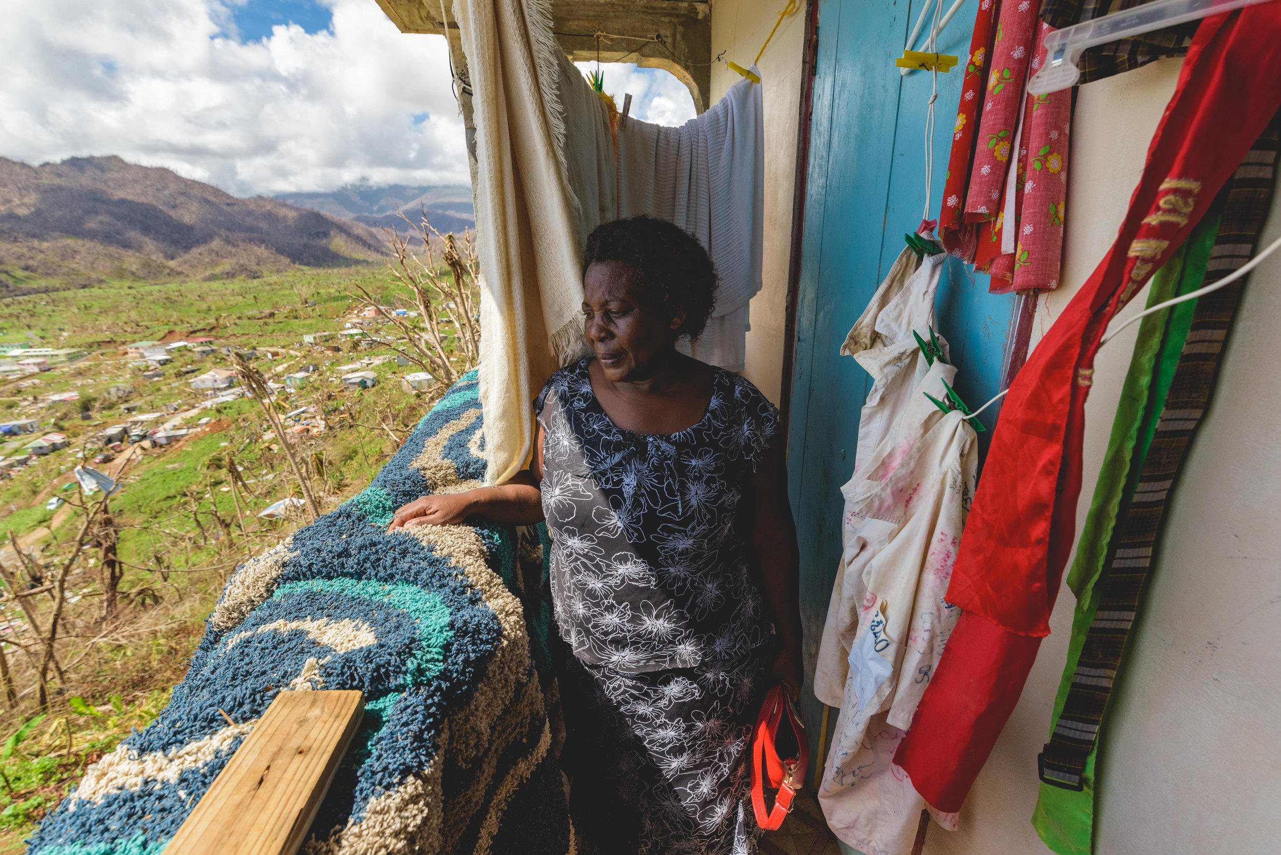 "Castle Bruce, Dominica - Angelica Gasper hid from Hurricane Maria in a small, 3X5 ft patio of her house. There, she prayed, ""God help me!"" for 4 hours while her home shook on it's stilts."