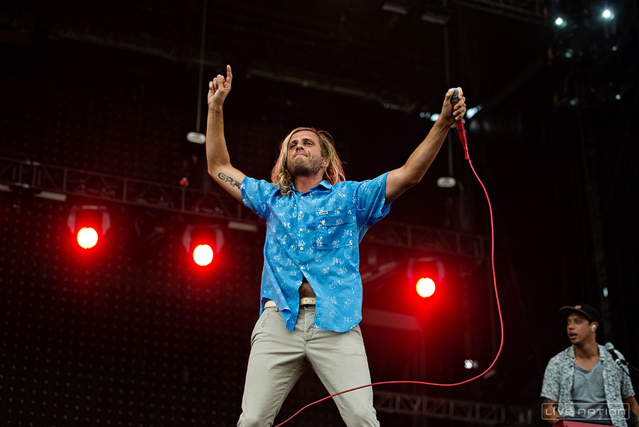 Aaron Bruno on stage with Awolnation [Source: Live Nation]