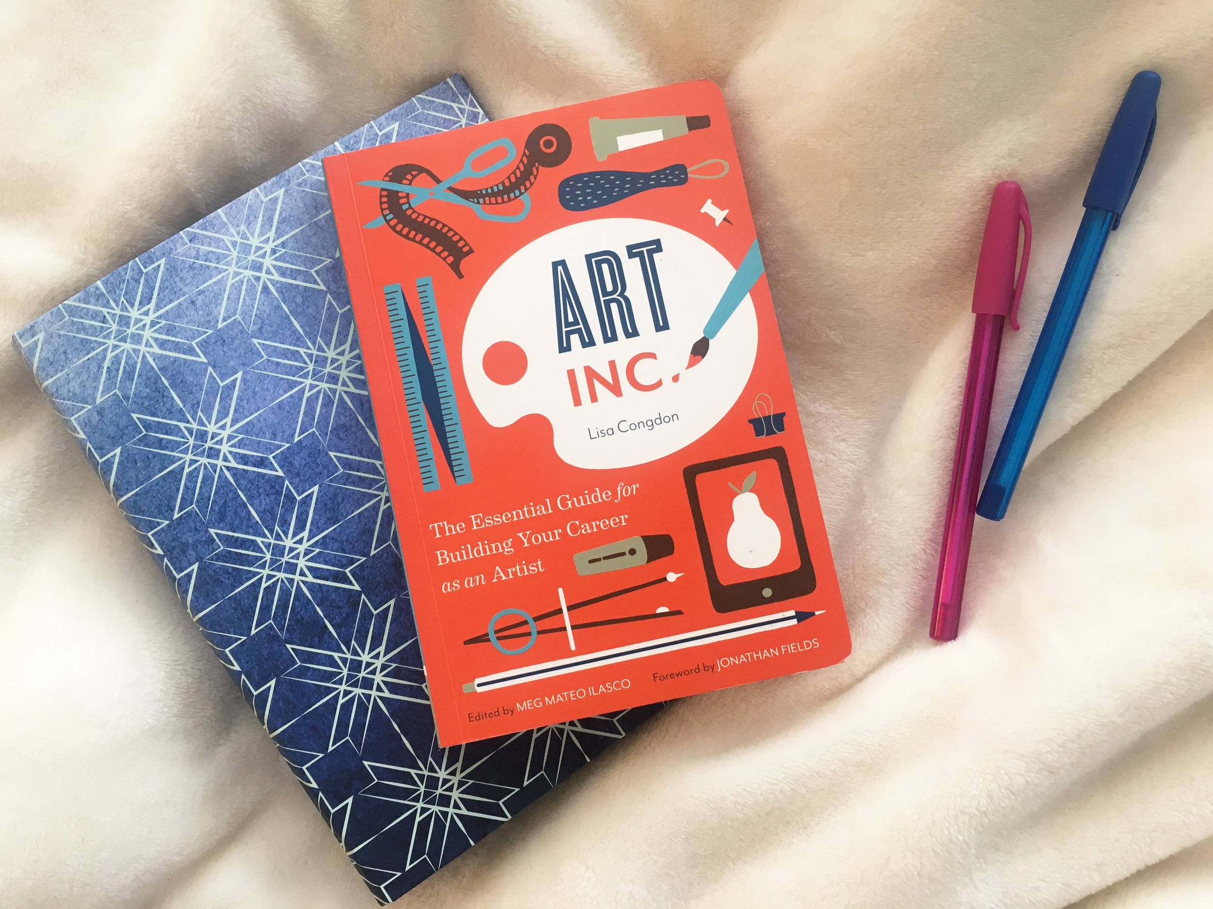 Lisa Congdon's amazing book Art Inc. and a cute binder I picked up from Target.