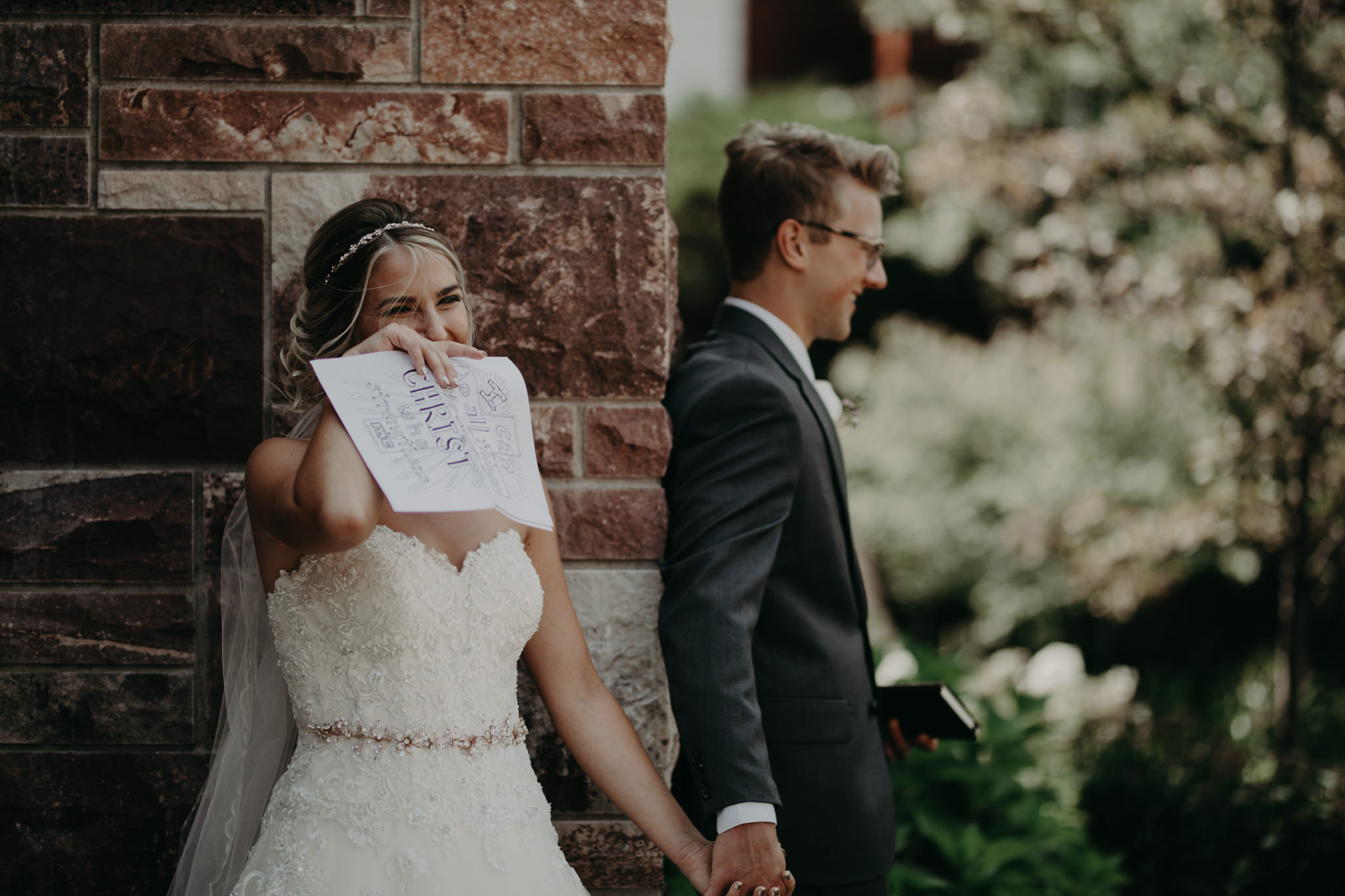 Bride and groom reading letters at St. Peter Cathedral in Marquette