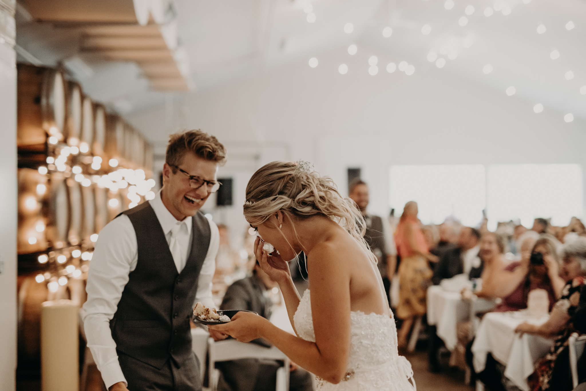 Bride and groom cake cutting at Barrel + Beam