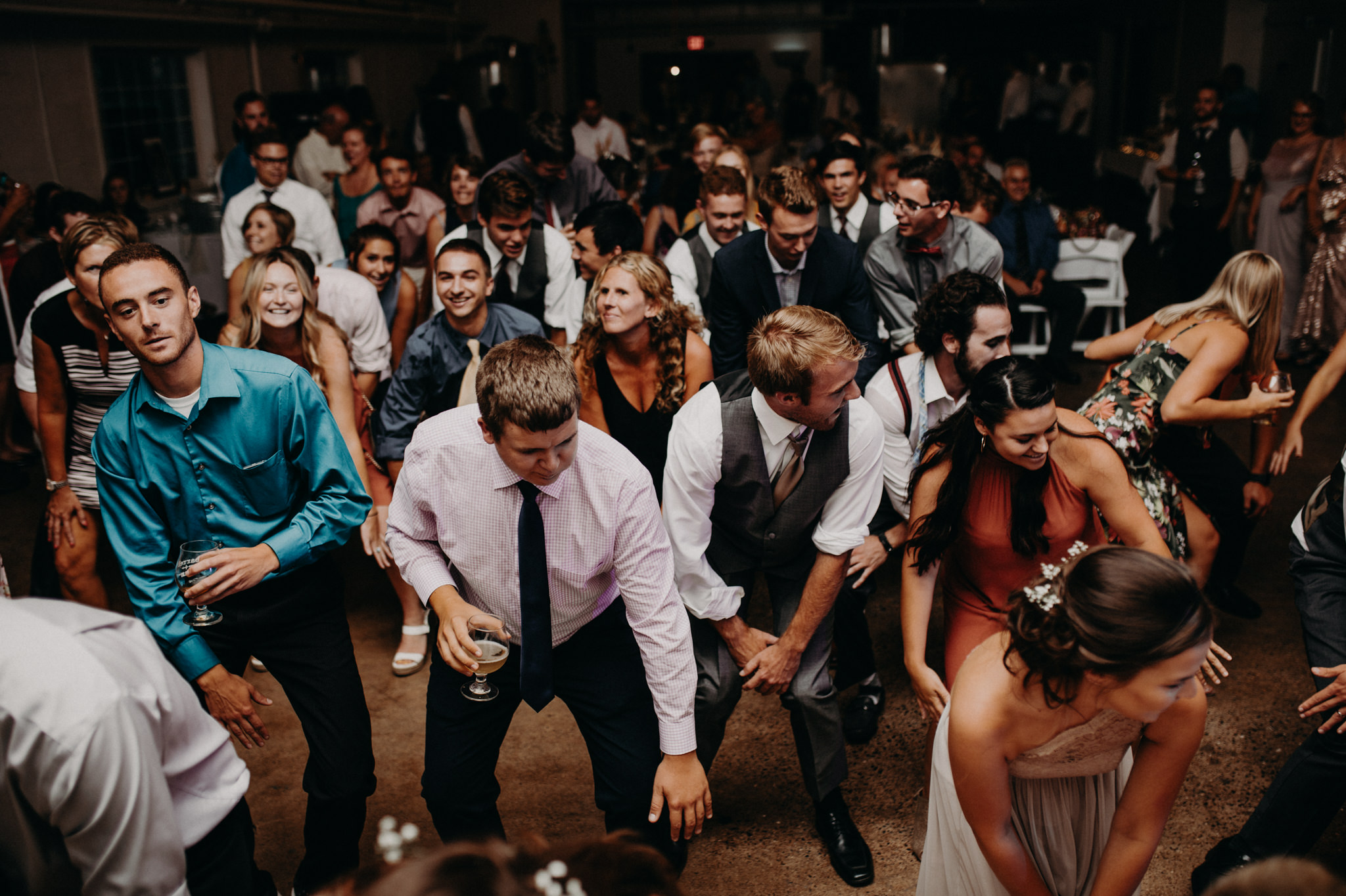Crown of wedding guests dancing to Cha Cha Slide