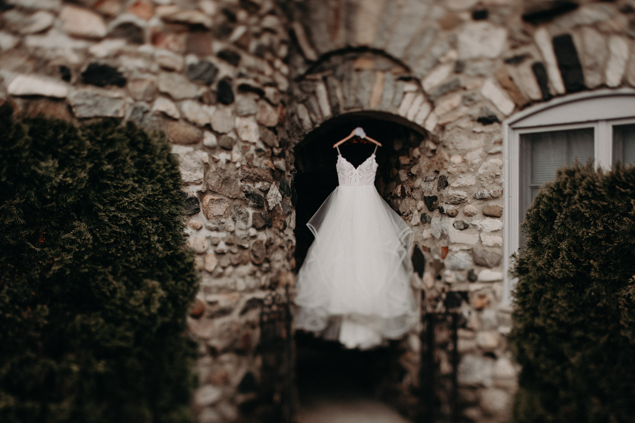 white beaded wedding dress hanging from Castle Farms Wedding Venue