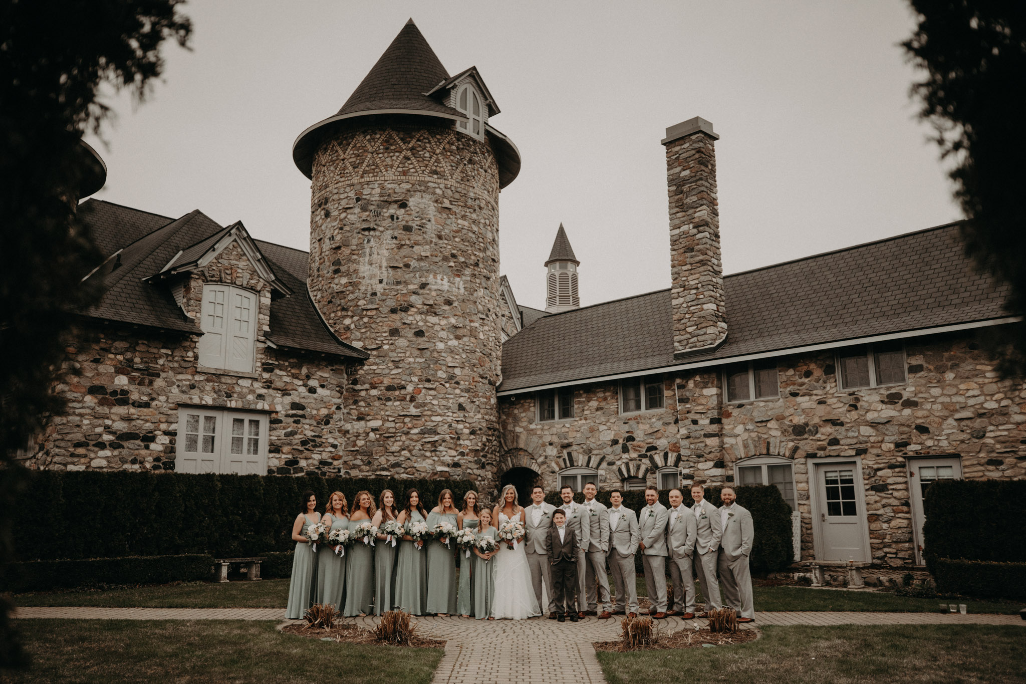 wedding party standing in front of castle farms