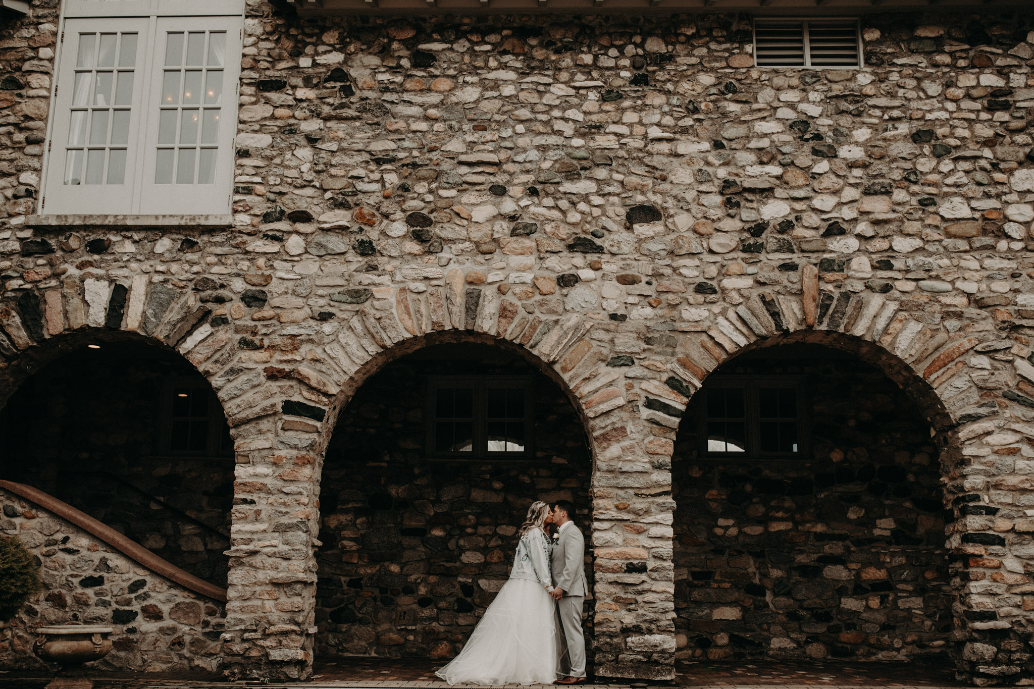 bride and groom standing in front of castle farms wedding