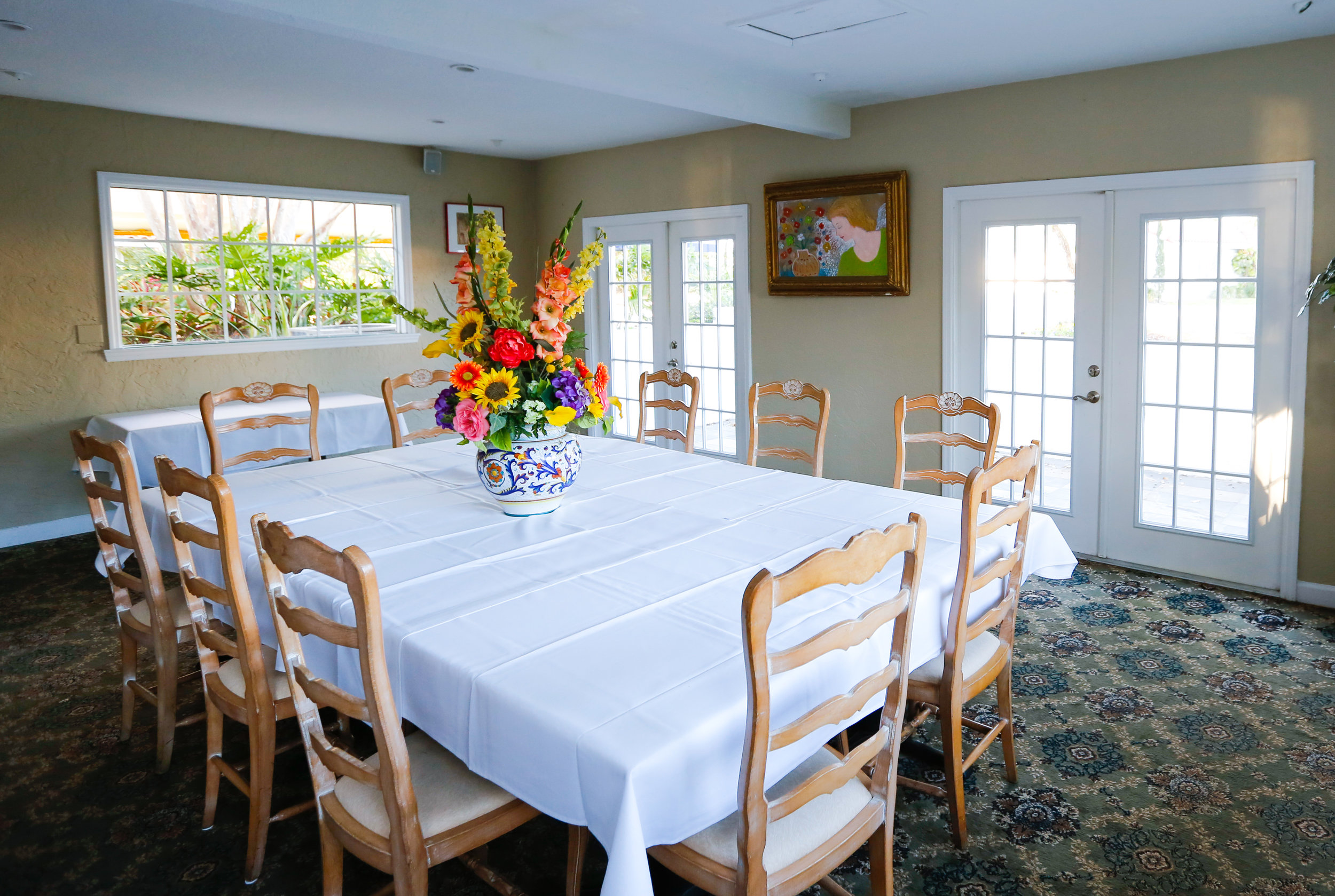 "Il Dolce Angolo   Il Dolce Angolo, or ""The Sweet Corner,"" can accommodate up to 40 guests. This room is often used for business meetings, receptions, holiday parties and birthday celebrations. The room can accommodate a conference style table for 22."