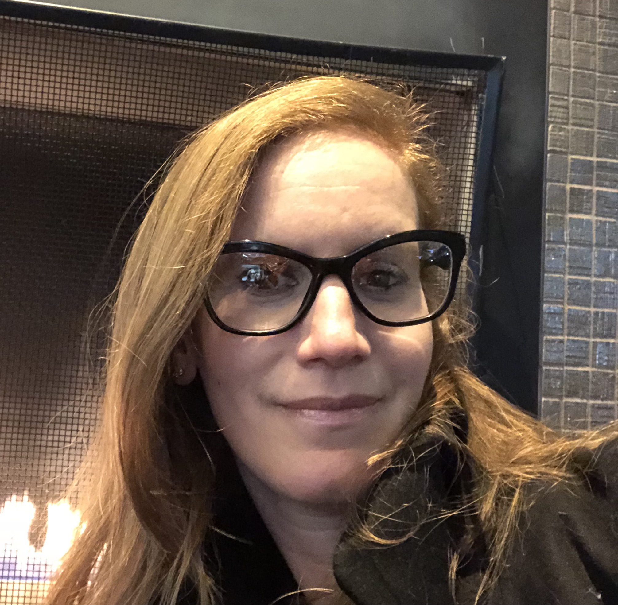 Cynthia snapped this selfie in the lobby of her Philly hotel right before we recorded this episode. Her glasses game is strong!