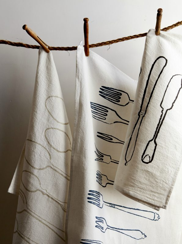 We have numerous handprinted cotton and linen tea towels including our favourite, Utensils.