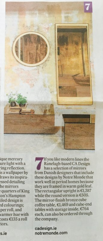 Warm gold leaf mirror and bronze cube coffee tables