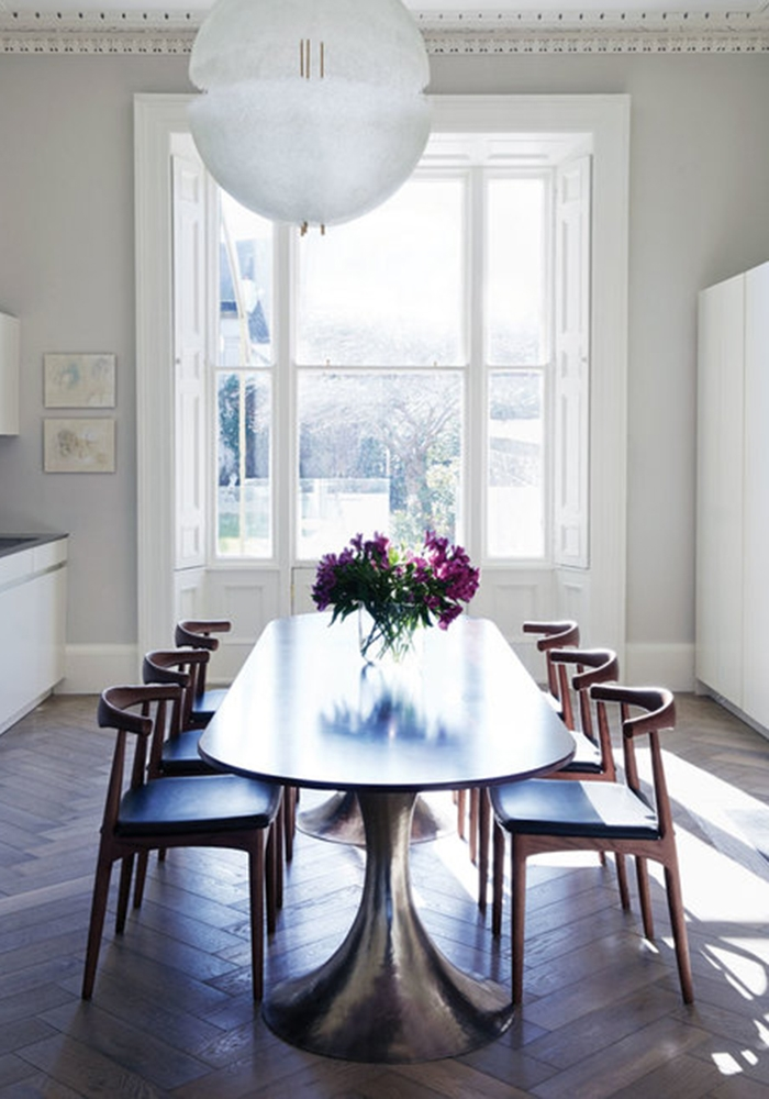 Studio 44   Leading Interior designer, Phillipa Buckley from Studio 44 design studio used walnut and leather Hans Wegner-style elbow chairs to complete a private client's home.