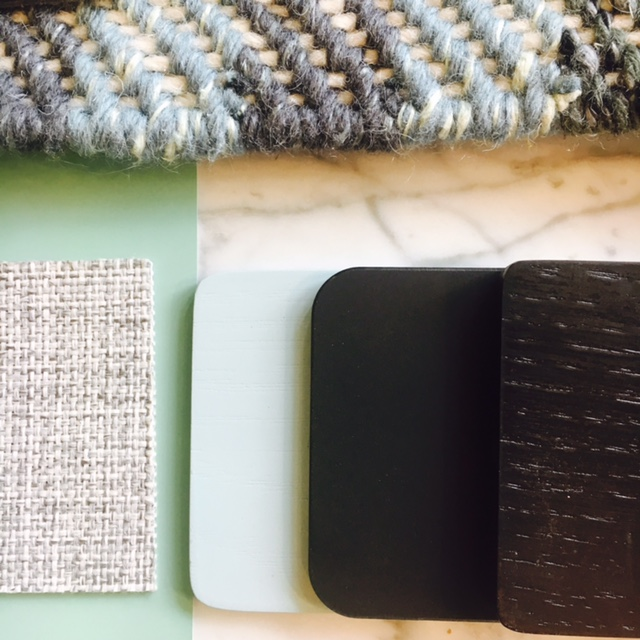 Love the juxtaposition of the dark, moody woods against the clean, minty shades of green and natural woven fabrics.
