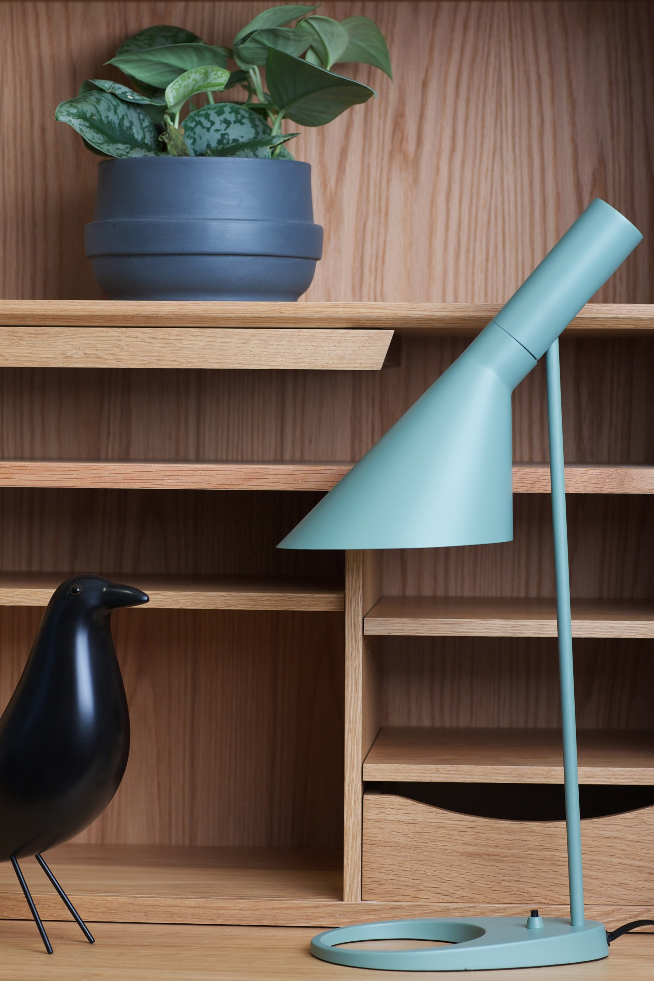 The new mint AJ Desk Lamp sitting pretty beside the classic Charles Eames-Style songbird. Shop  HERE.