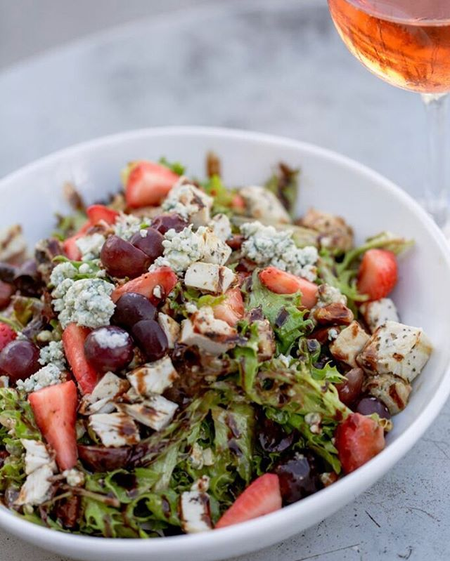 Nothing says summer like our refreshing Strawberry Fields salad and a glass of rose on the roof 🥗 🍷#summertimeandthelivingseasy #nashvilleunderground 📸 @angeleaphoto