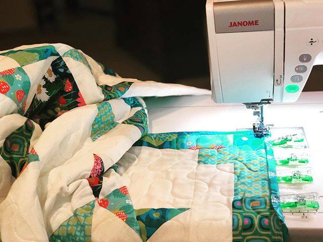 when adding the binding, puddle the quilt on your table so the machine feeds the quilt nicely thru the machine.