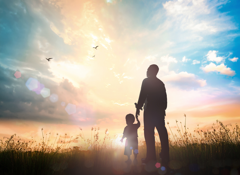 Child with his guardian under the full of sky