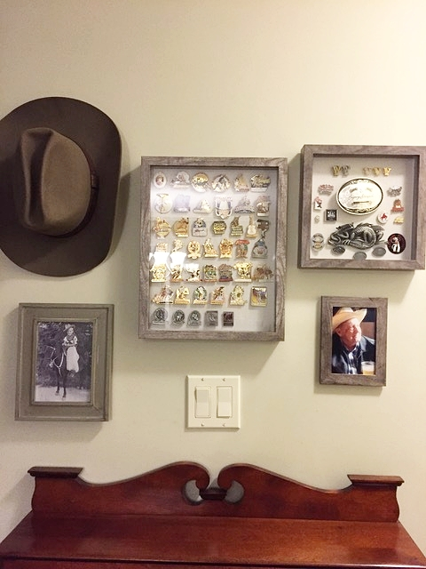 This is to honour my dad. His Stampede pins and belt buckles along with his second favourite hat (his favourite is with him).
