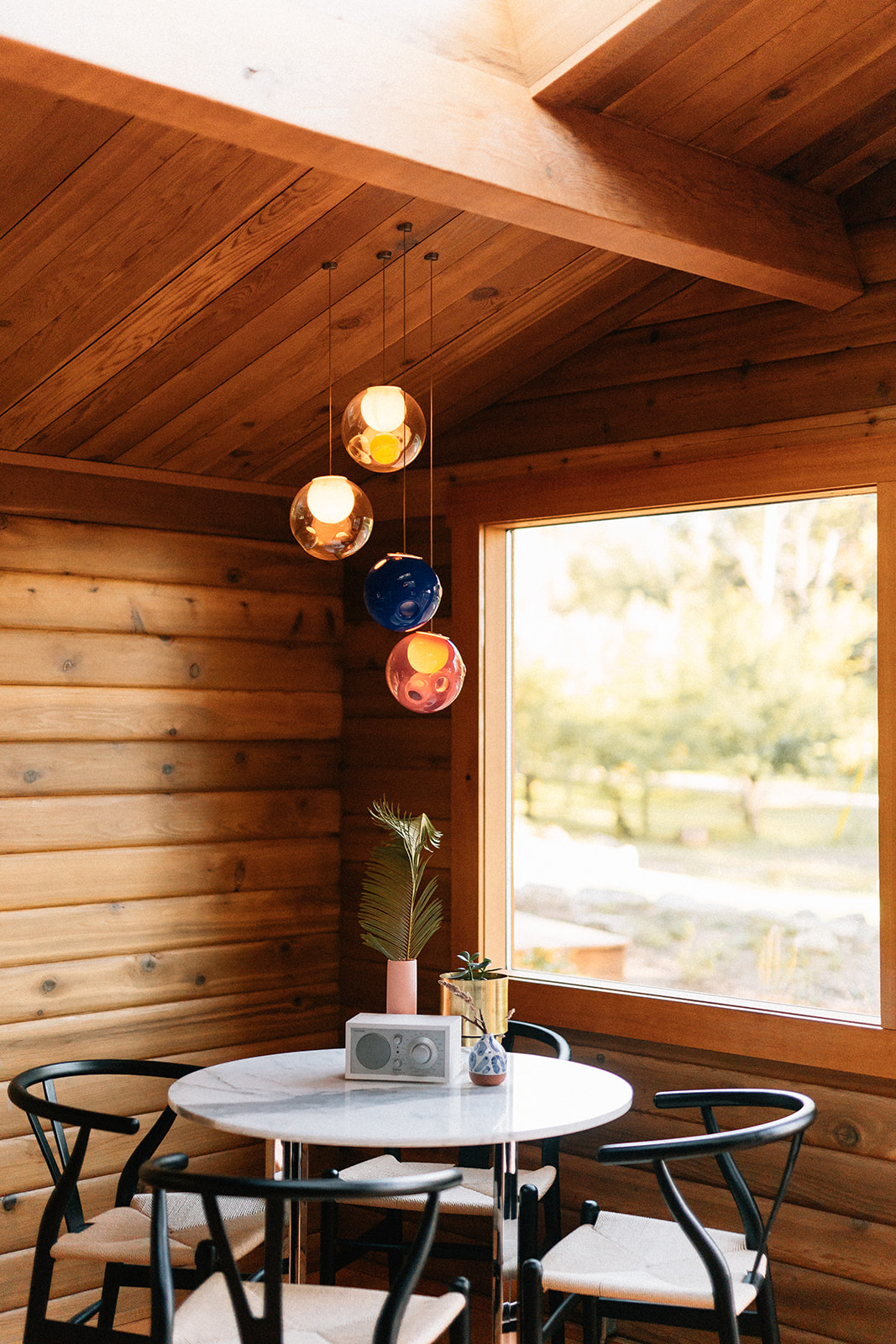 Custom Lighting - The interiors are illuminated with Bocci lighting, and CHARRED cedar LED pendants. bathrooms have custom arched backlit mirrors, illuminating the logs.