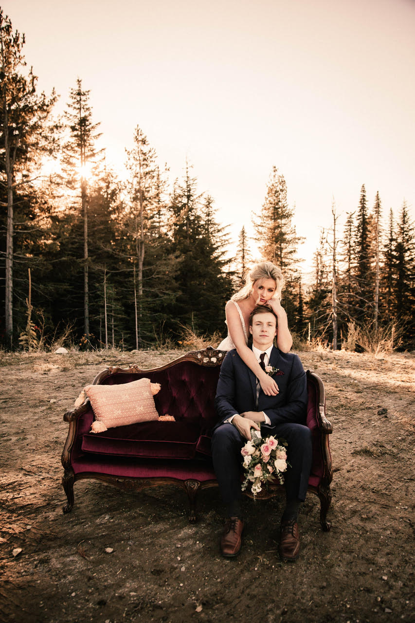 girl hugging groom on couch wedding dress image spokane