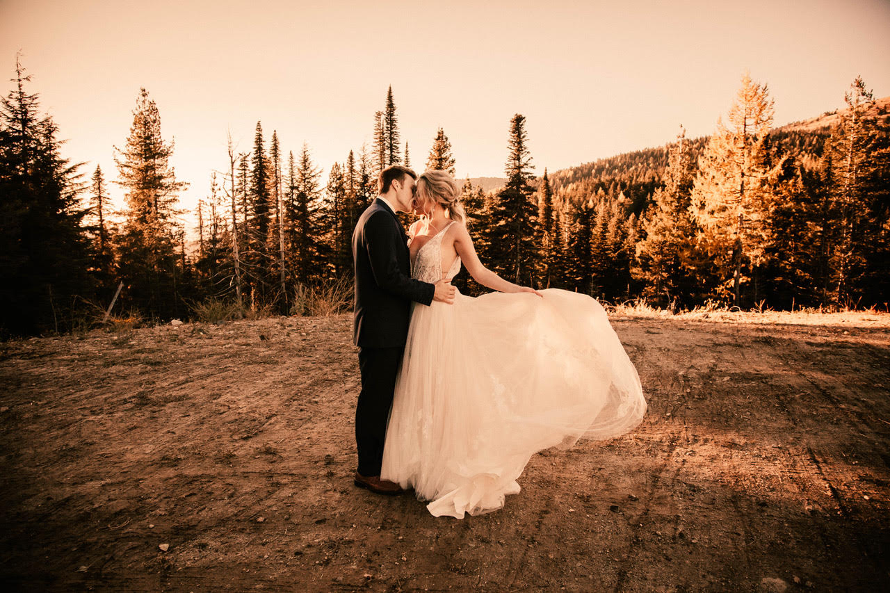 swirling and kissing image wedding dress spokane