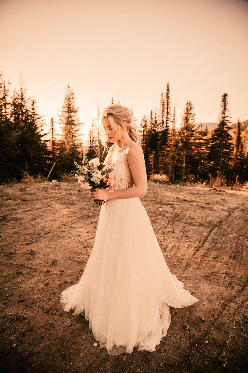bride holding bouquet in wedding dress spokane