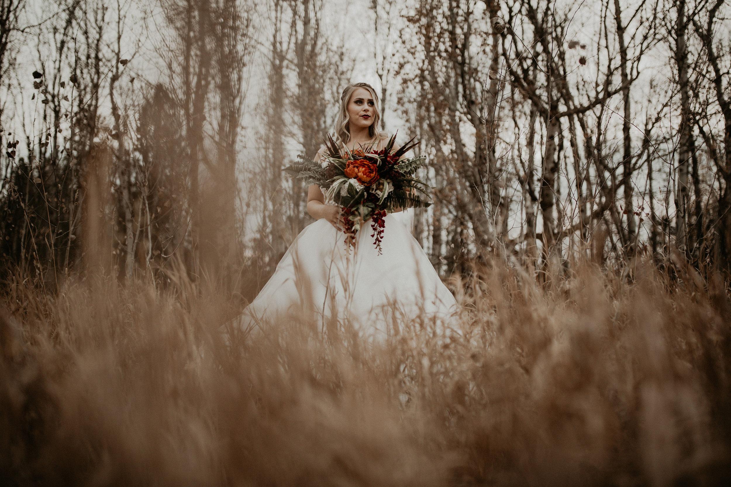 Spokane Fall wedding dress image in a field