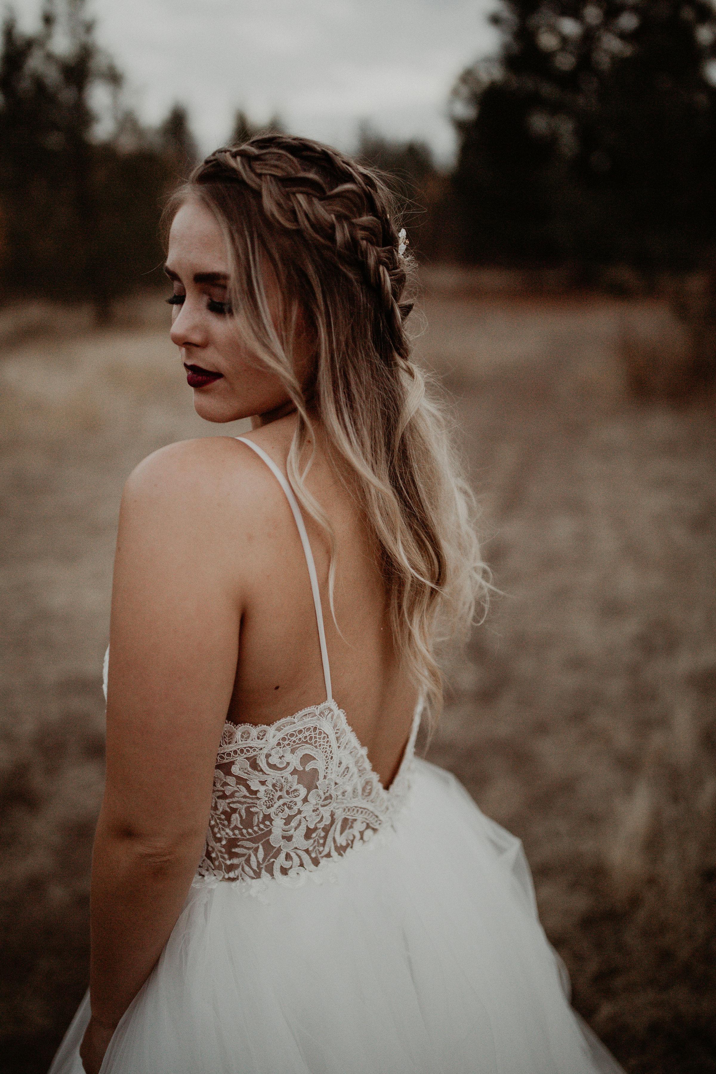 back of bridal gown butterfly tattoo braid Spokane