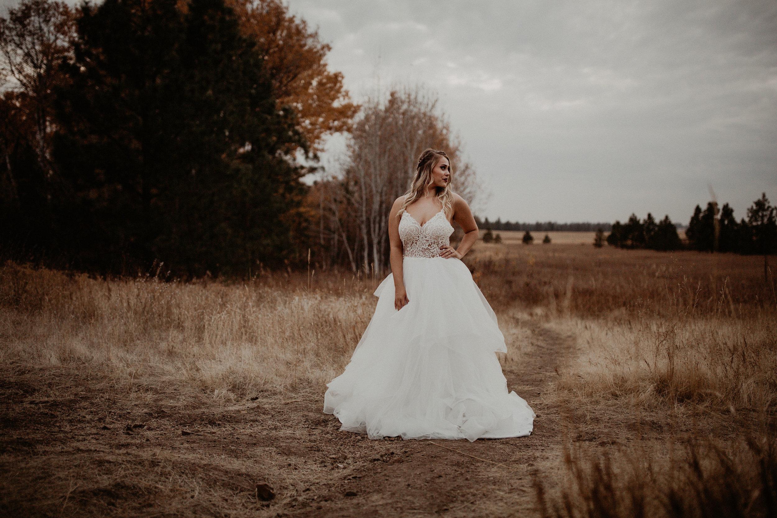 wedding dress in a field blonde bride