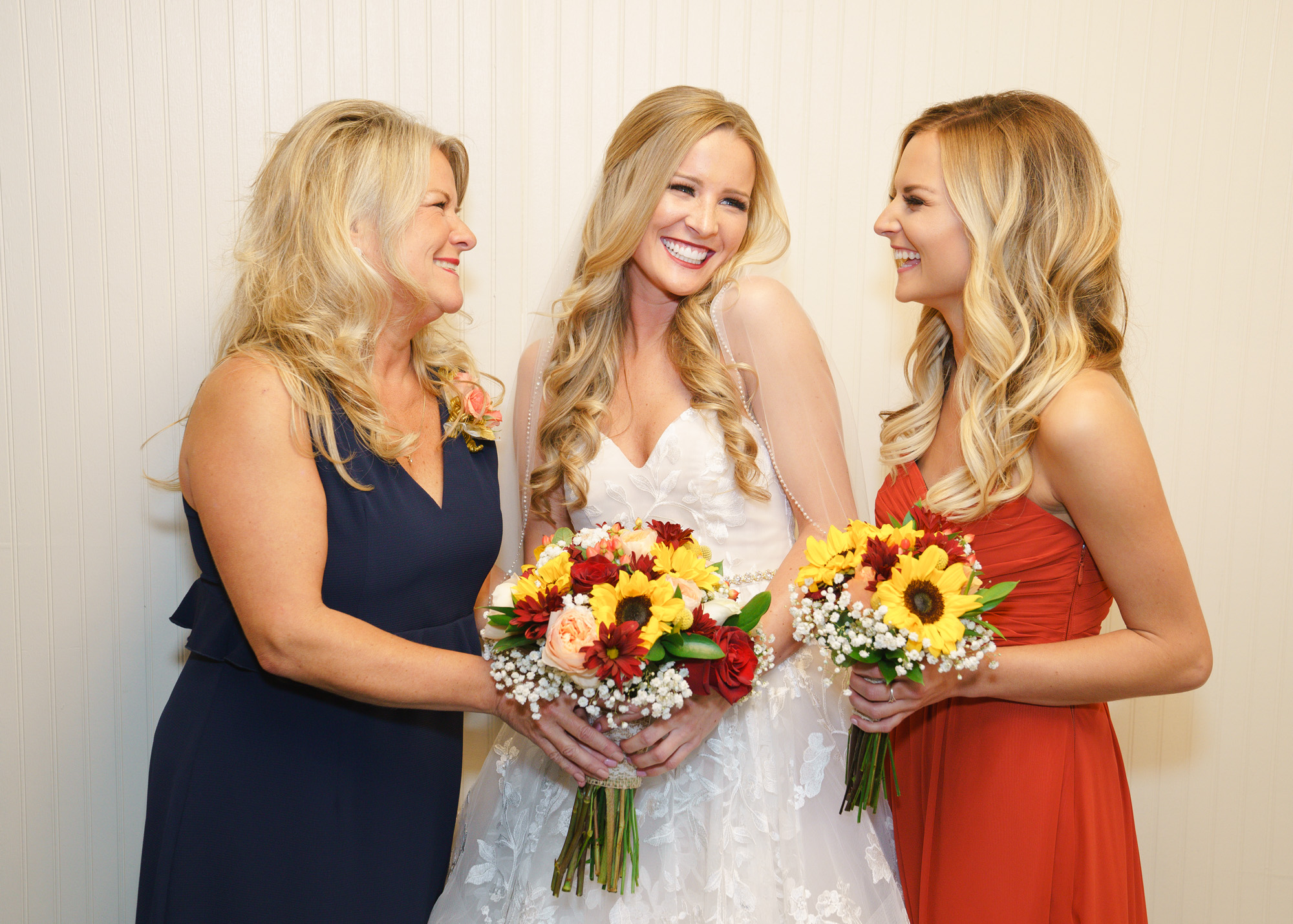 mother and sister with bride image