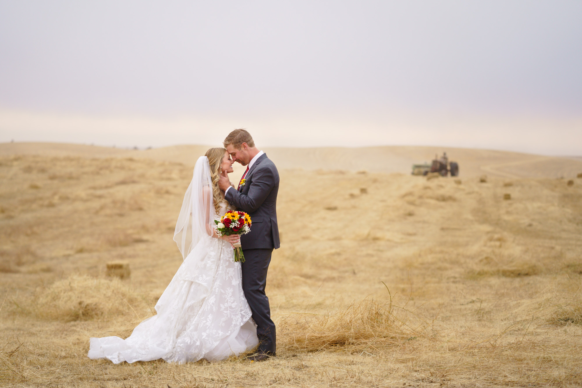 bride and groom in a field country wedding Spokane