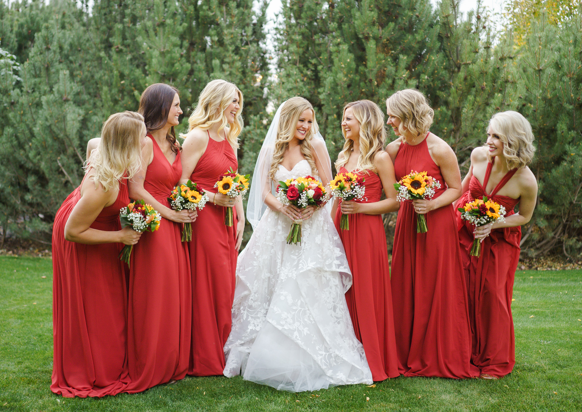 bridal party in red gowns spokane real wedding