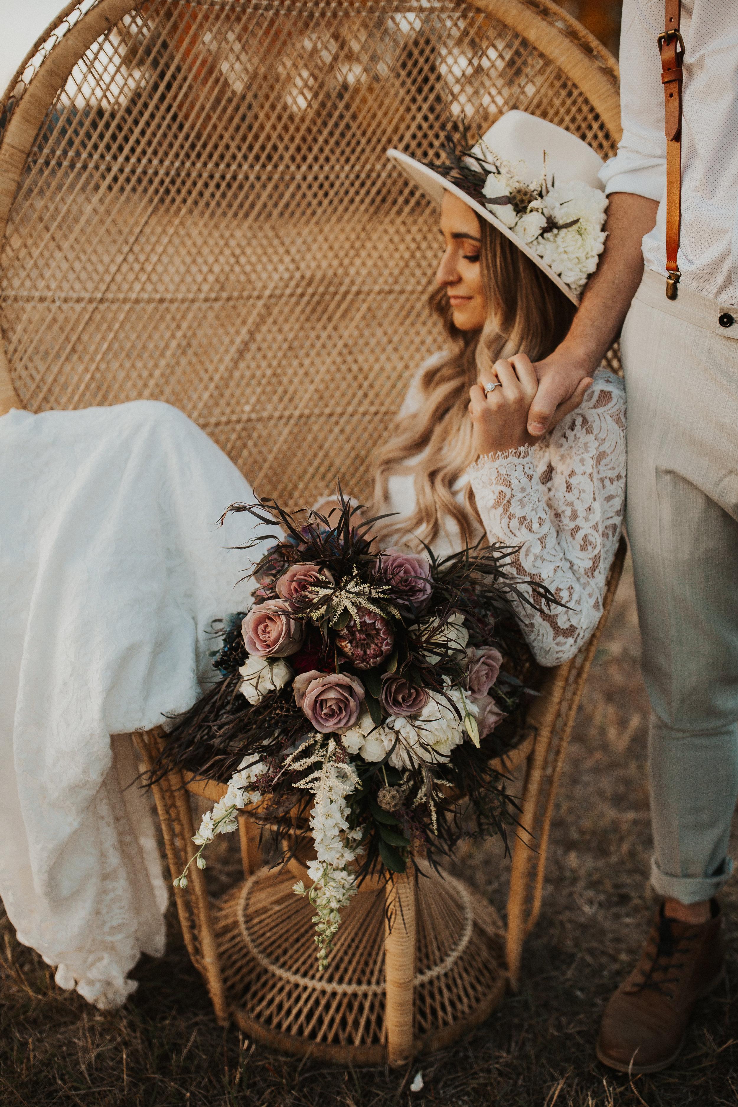 bride in peacock chair wedding inspo image