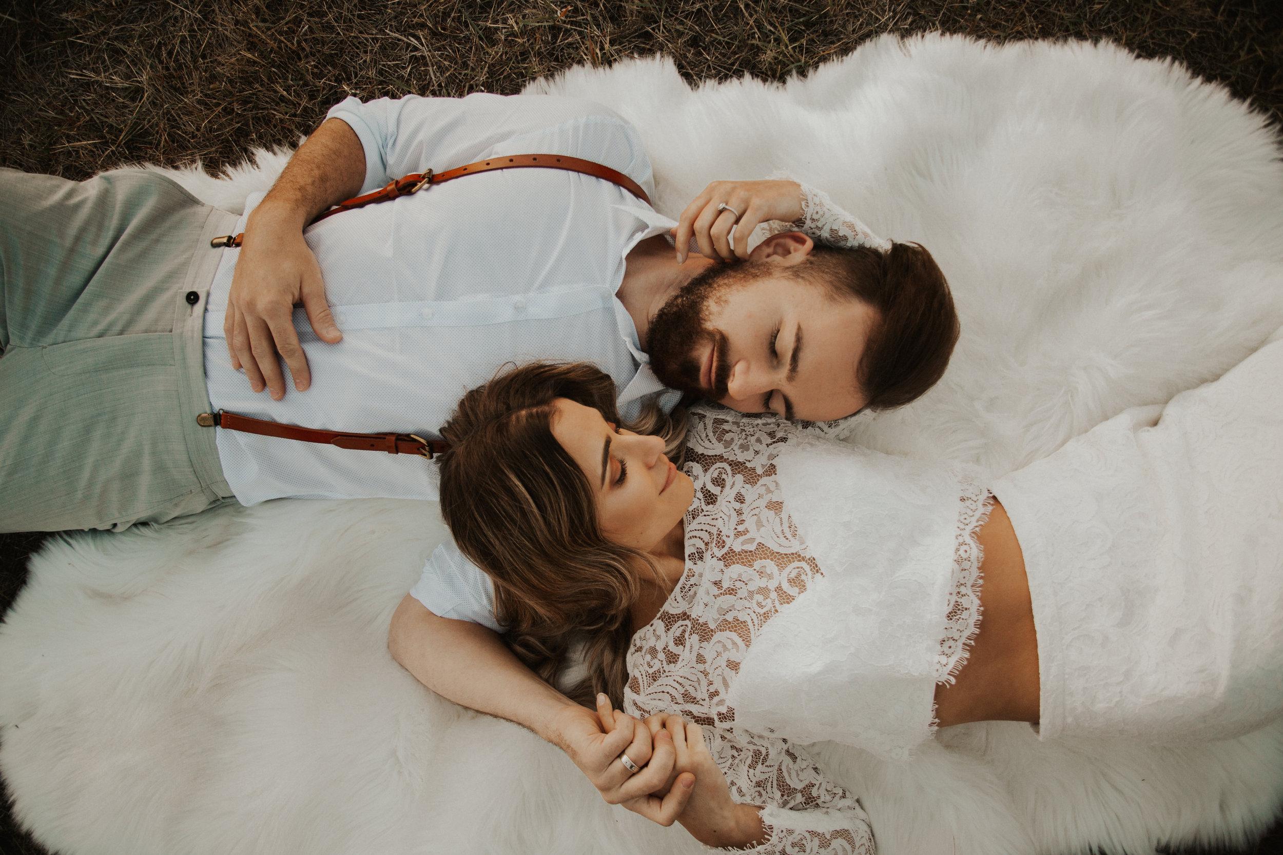 bridal couple laying on fur rug spokane
