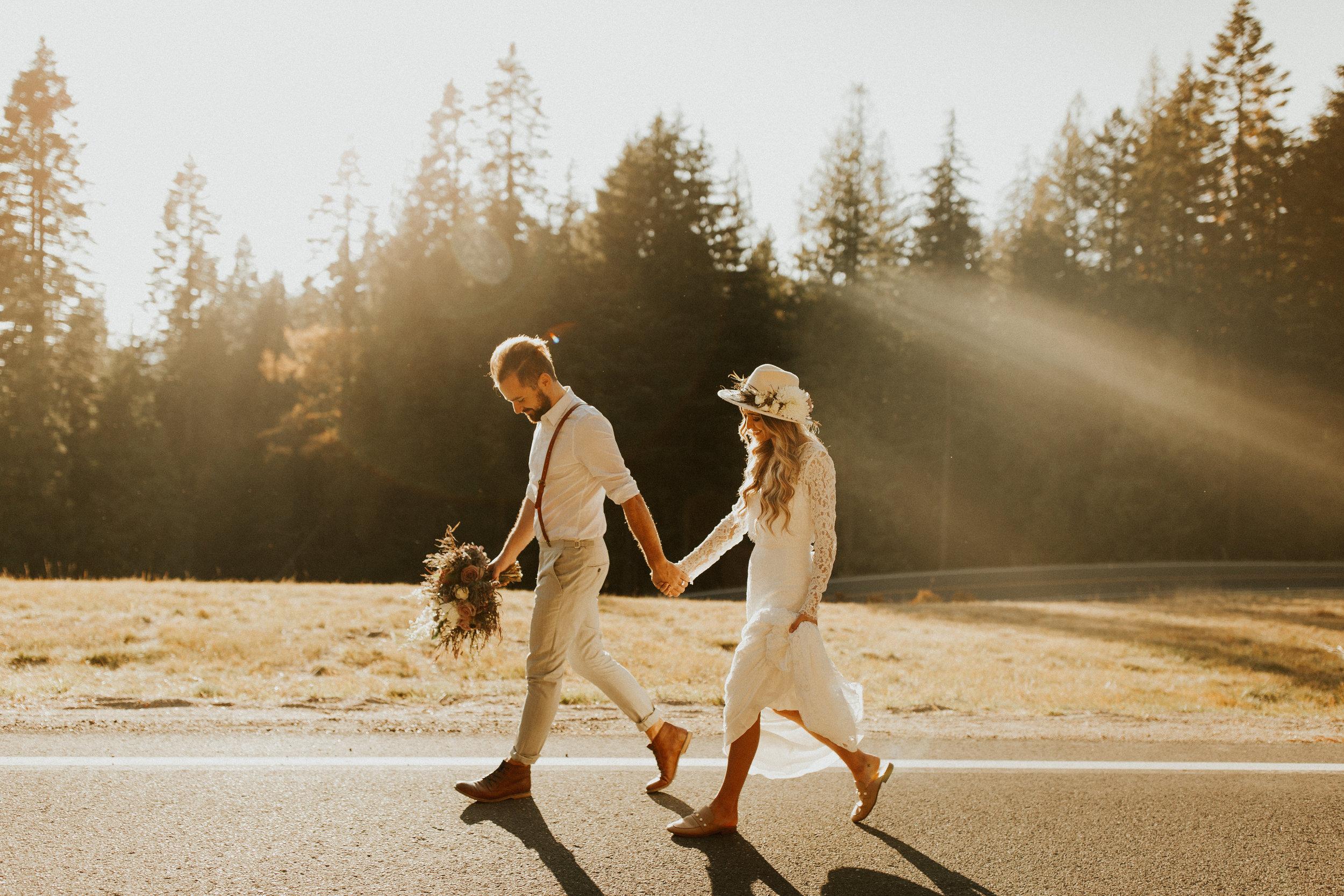image of bride and groom leaving wedding photo shoot at mt spokane