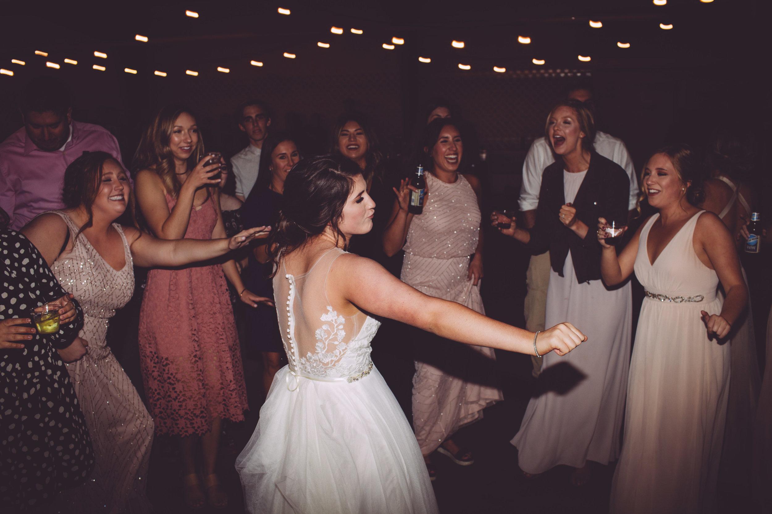 bride dancing with bridesmaids spokane real wedding