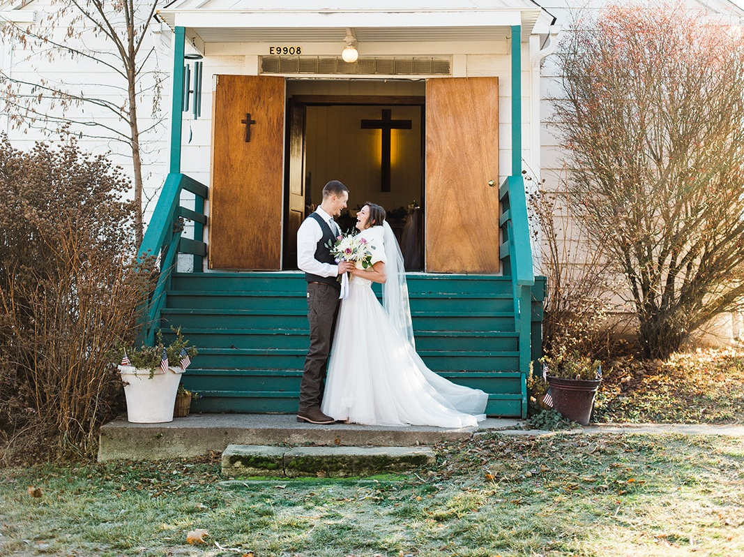 spokane+wedding+dress+green+bluff+winter+church+couple+on+stairs