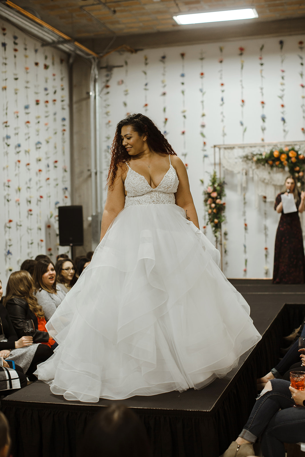 spokane wedding dress fashion show model walking the runway liz l'amour