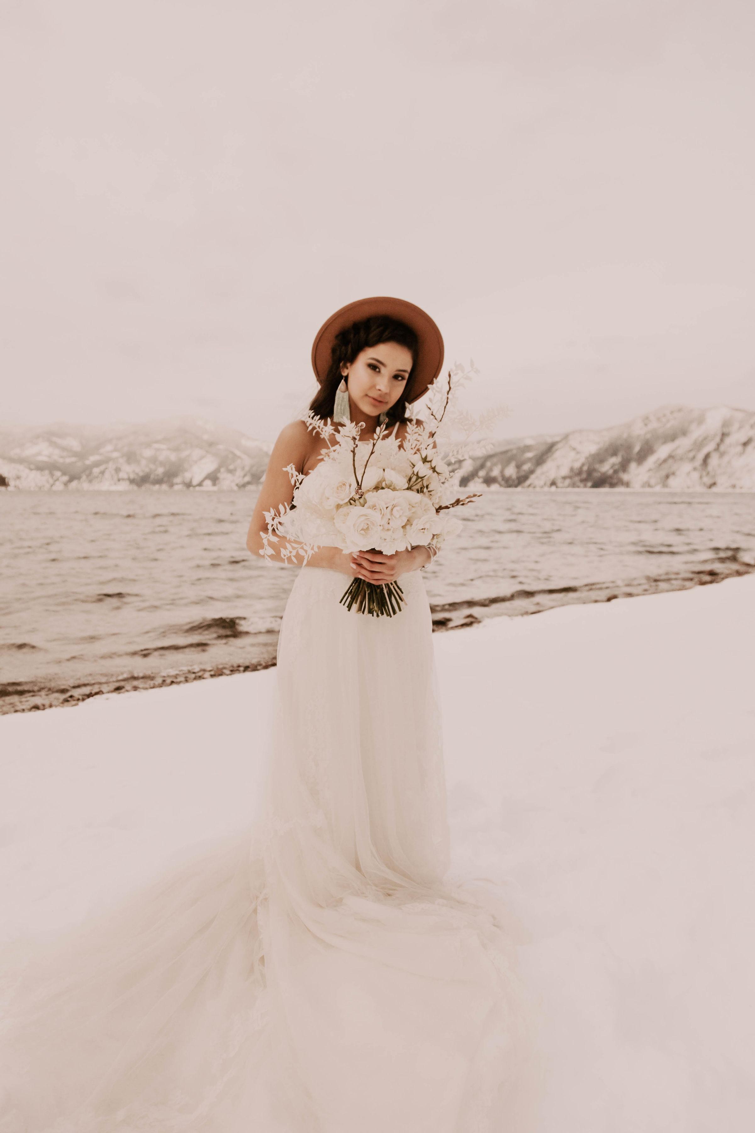 winter wedding bride spokane florals and brown hat
