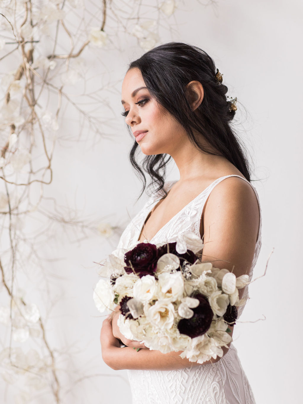 Dark hair bride with floral bouquet wedding spokane