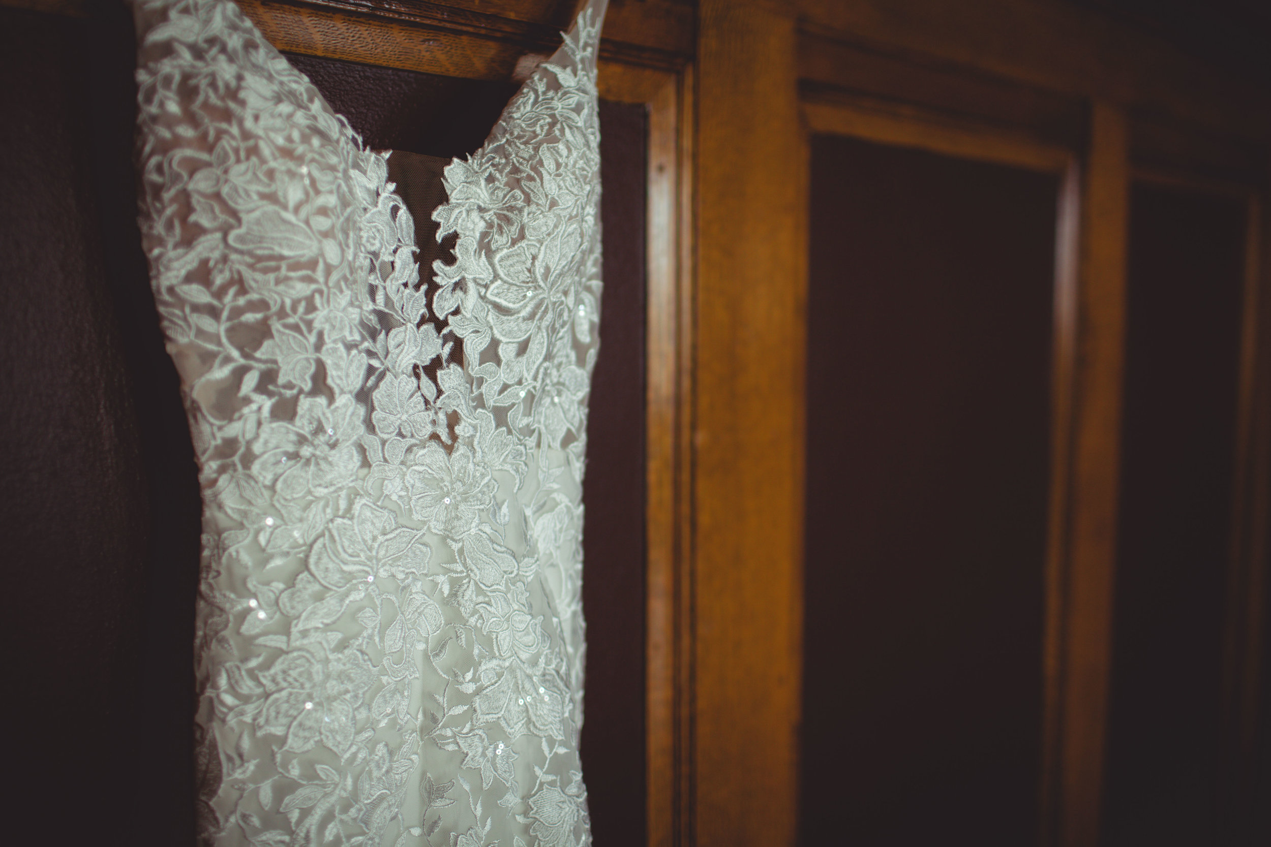 detail picture hanging wedding dress spokane bride