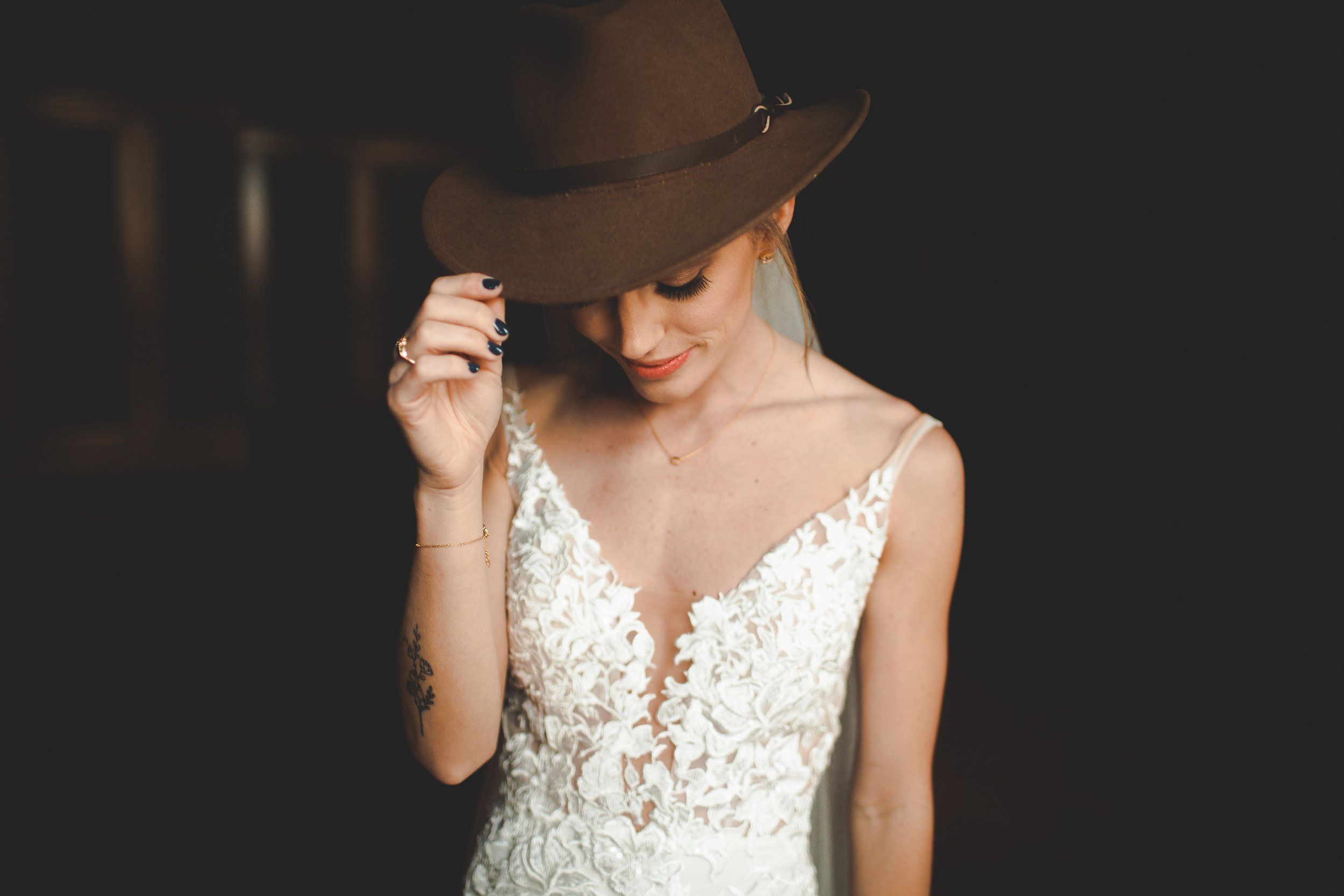 bride wearing suede hat wedding spokane