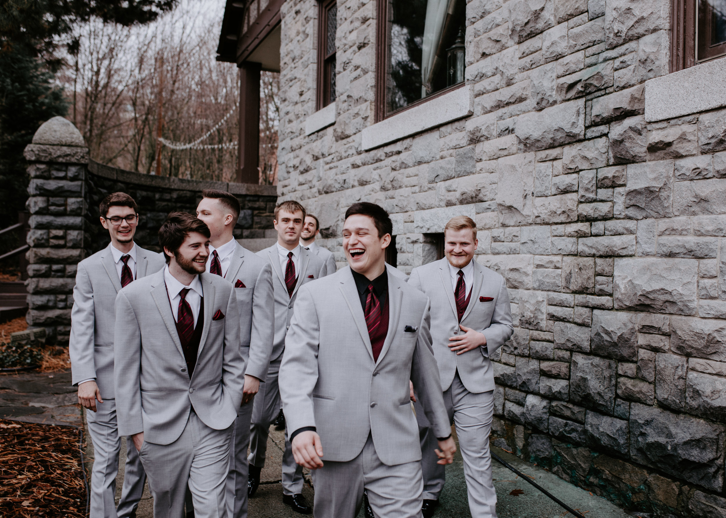 groomsmen walking spokane wedding bride