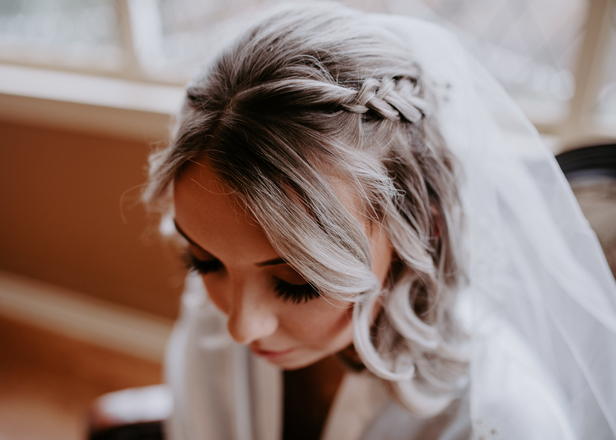 bride getting ready winter wedding spokane
