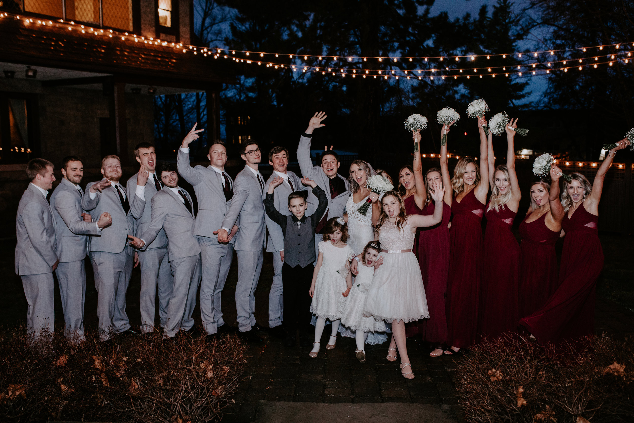 happy bridesmaids groomsmen bride groom spokane bridal shop