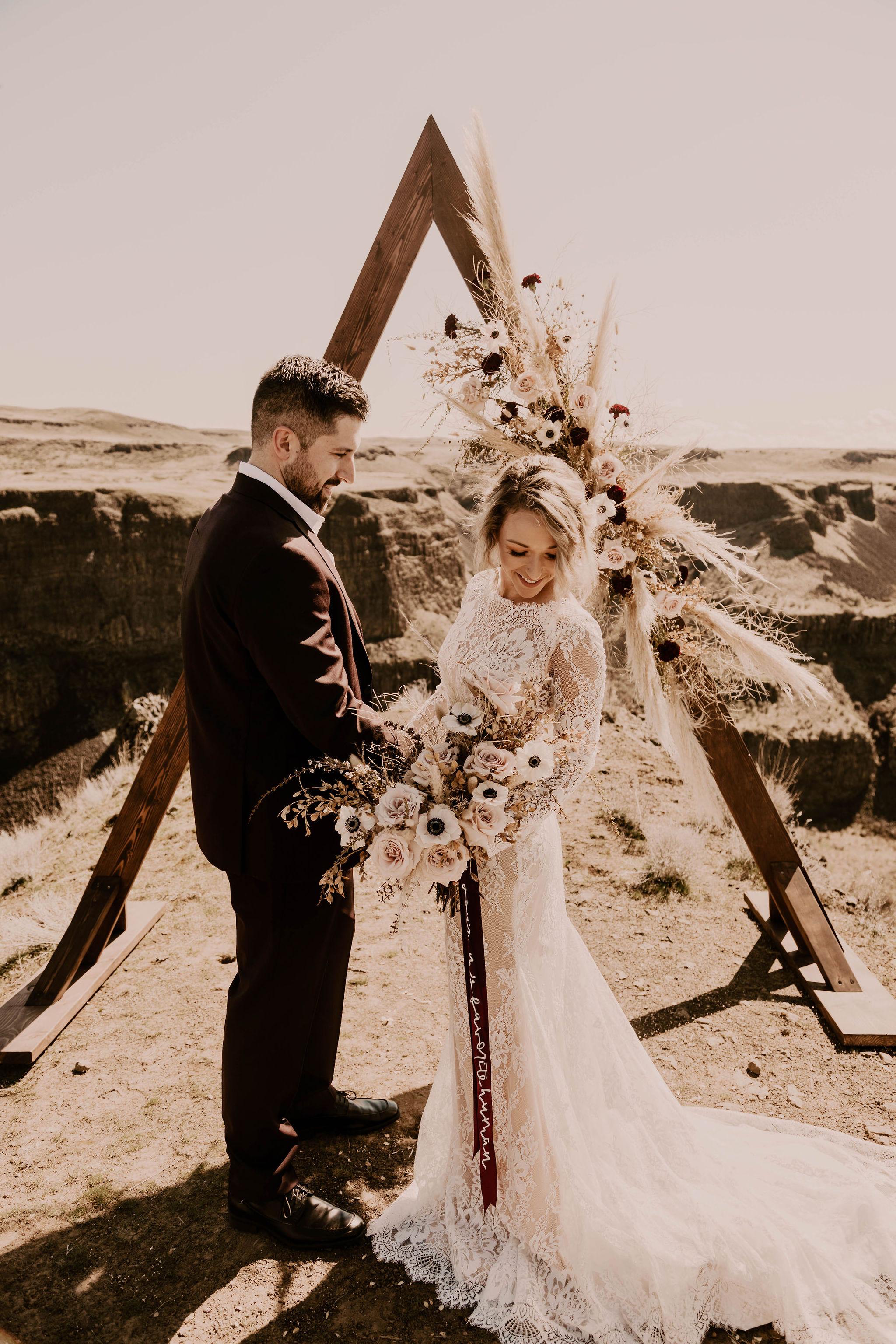 spokane destination wedding wooden arch bride