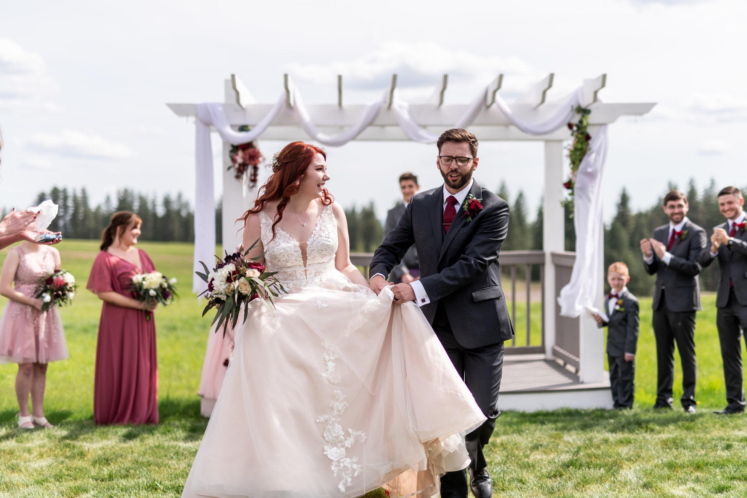 Spokane green bluff wedding dress bride aisle