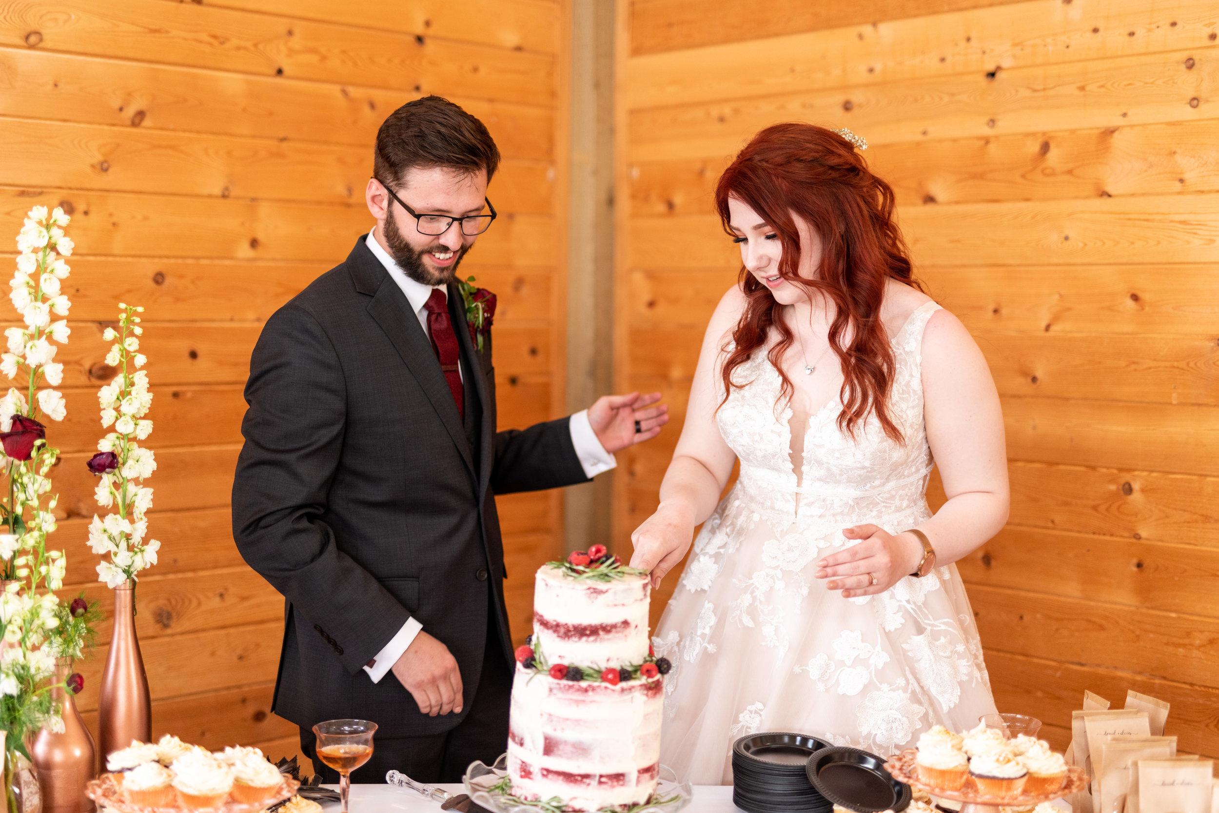 Spokane green bluff wedding dress bride cake cutting