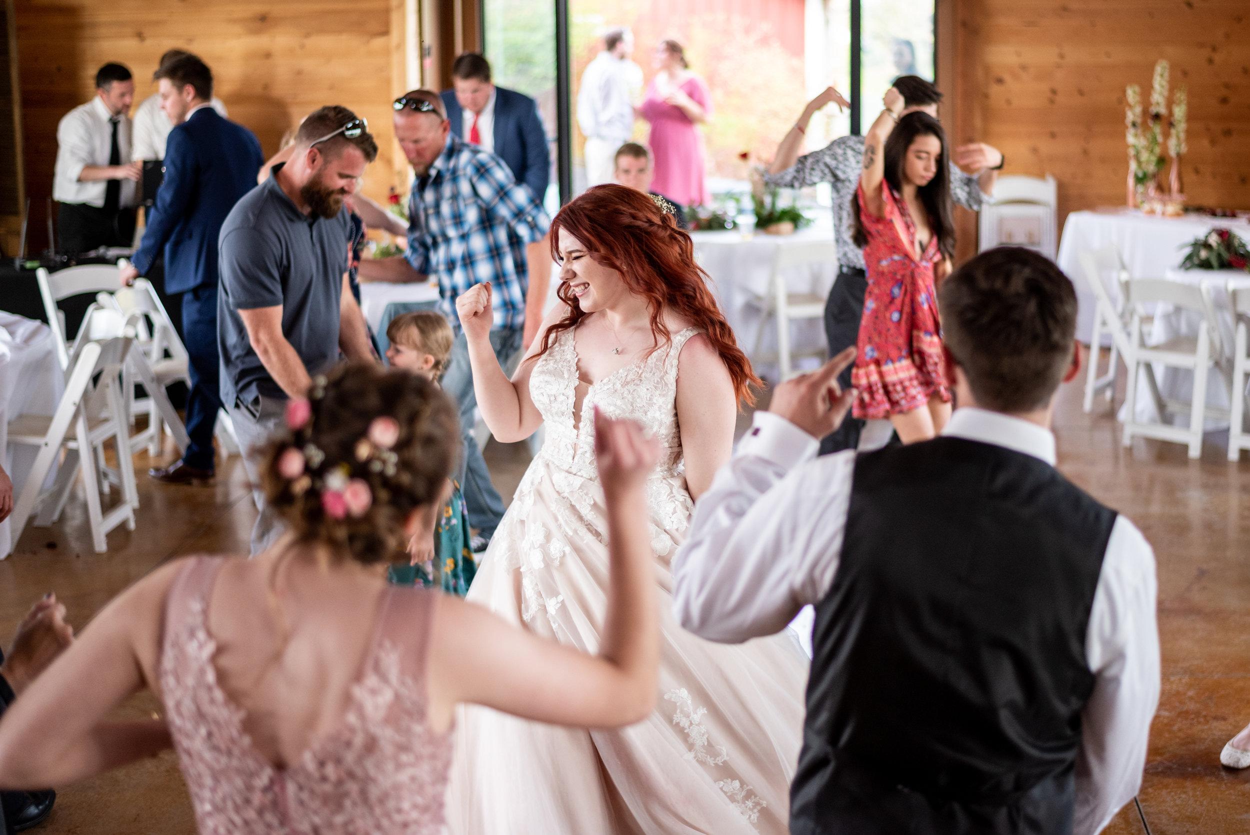 Spokane green bluff wedding dress bride dancing